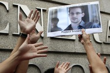 -                A supporter holds a picture of Edward Snowden, a former CIA employee who leaked top-secret information about U.S. surveillance programs, outside the U.S. Consulate General in Hong Kong