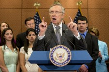 -                Senate Majority Leader Harry Reid of Nev., accompanied by families and friends of the Newtown, Conn. shooting victims, including siblings of Victoria Soto, Jillian Soto, left, Carlee So