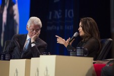 -                Former U.S. President Bill Clinton listens to Eva Longoria during a panel at the Clinton Global Initiative (CGI) meeting in Chicago, Thursday, June 13, 2013. During this opening session