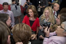 -                Former Gov. of Alaska Sarah Palin, with her husband Todd Palin, top left, greets supporters after speaking at the Faith and Freedom Coalition Road to Majority 2013 conference, Saturday,