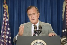 "-                FILE - In this file photo from Aug. 27, 1992, a year after the first Gulf War, U.S. President George H. Bush speaks at a White House news conference, wherein he announced a ""no fly zone"