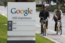 -                FILE - In this April 12, 2012 file photo, Google workers ride bikes outside of Google headquarters in Mountain View, Calif. Google on Tuesday, June 18, 2013, sharply challenged the fede