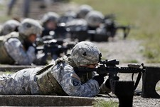 -                FILE - In this Sept. 18, 2012 file photo, female soldiers from 1st Brigade Combat Team, 101st Airborne Division train on a firing range while testing new body armor in Fort Campbell, Ky