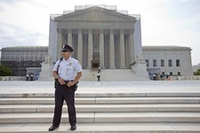 -                A police officer keeps watch outside the Supreme Court in Washington, Monday, June 17, 2013. With a week remaining in the current Supreme Court term, several major cases are still outst