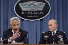 -                FILE – In this May 17, 2013 file photo Defense Secretary Chuck Hagel, left, and Chairman of the Joint Chiefs of Staff, Gen. Martin Dempsey take turns talking to media during a news conf