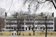 -                FILE--In this photo taken on March 12, 2012, students walk across the Dartmouth College campus green in Hanover, N.H. High school students hoping to earn college credits through Advance