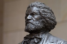 -                A bronze statue of 19th-century orator and writer Frederick Douglass is seen in the Emancipation Hall of the United States Visitor Center on Capitol Hill in Washington, Wednesday, June