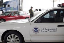 -                A U.S. Customs and Border Patrol agent  keeps watch at a checkpoint station, on Feb. 22, 2013, in Falfurrias, Texas. Some drug smugglers caught at the highway checkpoint about an hour n