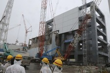 -                FILE - In this Wednesday, June 12, 2013 file photo, the steel structure for the use of the spent fuel removal from the cooling pool is seen at the Unit 4 of the Fukushima Dai-ichi nucle