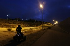 -                In this June 13, 2013 picture, a U.S. Border Patrol agent rides an ATV as he patrols at night between the border structures separating Tijuana, Mexico, left, from San Diego. Illegal imm