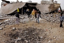 -                FILE - in this file photo taken on  Dec. 17, 2012 People inspect the scene of a car bomb attack in al-Mouafaqiyah, a village inhabited by families from the Shabak ethnic group, near the
