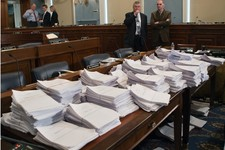 -                FILE - This May 15, 2013 file photo shows stacks of paperwork awaiting members of the House Agriculture Committee on Capitol Hill in Washington, Wednesday, May 15, 2013, as it meets to