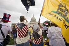 -                In this June 19, 2013, photo, Tea Party activists attend a rally on the grounds of the Capitol in Washington, Wednesday, June 19, 2013. Six months after Hispanics overwhelmingly helped