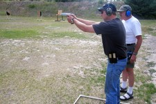 -                FILE - In this Aug. 5, 2009, file photo Gary Marbut, right, works with Brad Stemple, left, on a shooting range in Missoula, Mont. After Montana passed a 2009 law crafted by Marbut decla