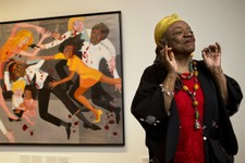 "-                Artist Faith Ringgold talks about her artwork in front of her painting, ""Die (1967)"" during a press preview of her exhibition, ""American People, Black Light: Faith Ringgold's Paintings"