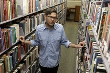 -                Josh Kun, the curator who organized a collection of music themed around Loa Angeles poses for a picture at the main branch of the Los Angeles Public Library Friday, June 21, 2013 in Los