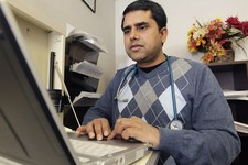 -                In this Thursday, March 28, 2013 photo, Dr. Damodar Poudel works on patient records at Family Healthcare Inc., in Chillicothe, Ohio. A shortage of primary care physicians in parts of th