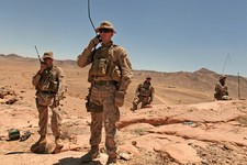 -                FILE - In this Wednesday, June 19, 2013 file photo, U.S. Marines talk to their comrades on the ground during Eager Lion multinational military maneuvers in Quweira, 186 miles south of A