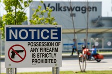 -                In this June 12, 2013, photo, a sign at the Volkswagen plant in Chattanooga, Tenn., warns against bringing firearms onto the property. The German automaker has opposed a state law decri