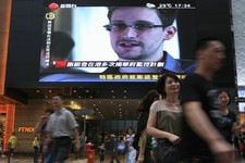 -                A TV screen shows a news report of Edward Snowden, a former CIA employee who leaked top-secret documents about sweeping U.S. surveillance programs, at a shopping mall in Hong Kong Sunda
