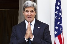 -                U.S. Secretary of State John Kerry makes a gesture of greeting to the media at the end of a photo opportunity with Indian Foreign Minister Salman Khurshid, not pictured, at Hyderabad Ho