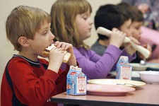 -                FILE- In this Feb. 3, 2010 file photo, students eat lunch at Sharon Elementary School in Sharon, Vt. Vermont ranks second in the country in an annual report of kids' well-being. The Ann