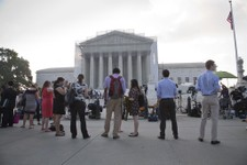 -                People wait outside the Supreme Court in Washington as key decisions are expected to be announced Monday, June 24, 2013. At the end of the court's term, several major cases are still ou
