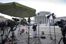 -                TV crews wait outside the Supreme Court in Washington as key decisions are expected to be announced Monday, June 24, 2013. At the end of the court's term, several major cases are still