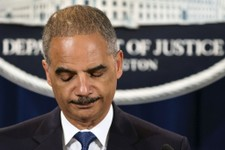 -                Attorney General Eric Holder expresses disappointment in the Supreme Court's 5-4 ruling in the Alabama voting rights case, Shelby County v. Holder, Tuesday, June 25, 2013, at the Justic