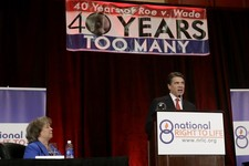 -                Carol Tobias, president of National Right To Life, left, watches as Gov. Rick Perry delivers a speech to a large audience in attendance at the national convention, Thursday, June 27, 20
