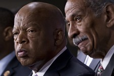 -                FILE - In this June 25, 2013 file photo, Rep. John Lewis, D-Ga., left, and Rep. John Conyers, D-Mich., right, co-chairs of the Civil Rights Taskforce of the Congressional Black Caucus,