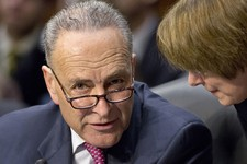 -                FILE – In this May 9, 2013, file photo Sen. Chuck Schumer, D-N.Y., left, confers with Sen. Amy Klobuchar, D-Minn., as the Senate Judiciary Committee meets on immigration reform on Capit
