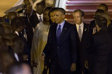 -                U.S. President Barack Obama, center, accompanied by first lady Michelle Obama, center left, greets Senegalese dignitaries as he arrives at the airport in Dakar, Senegal, Wednesday, June