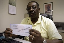 -                In this Wednesday, June 19, 2013 photo, Wayne Bostic holds his last pay-stub dating back over two years in Raleigh, N.C. Bostic lost his job and has been collecting extended unemploymen