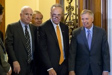 "-                Members of the bipartisan ""Gang of Eight"" who crafted the immigration reform bill, Sen. Chuck Schumer, D-N.Y., center, flanked by Sen. John McCain, R-Ariz., left, and Sen. Lindsey Graha"