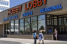 -                FILE - In this May 22, 2013, customers enter and exit a Hobby Lobby store in Denver. A federal appeals court on Thursday, June 27, 2013 ruled that Hobby Lobby stores have a good case th