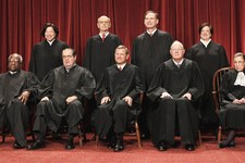 -                FILE -In this Oct. 8, 2010 file photo, members of the Supreme Court gather for a group portrait at the Supreme Court in Washington. Seated from left are: Associate Justices Clarence Tho