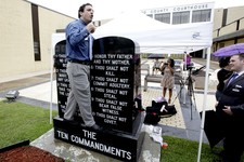 -                David Silverman, president of American Atheists, stands on a Ten Commandments and says why he thinks it shouldn't be there after Eric Hovind (not pictured), with Creation Today, stood o
