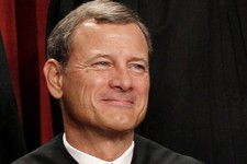 -                FILE - In this Oct. 8, 2010 file photo, Chief Justice John Roberts is seen during the group portrait at the Supreme Court Building in Washington. A historic Supreme Court term ended wit