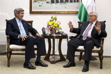 -                U.S. Secretary of State John Kerry, left, meets with Palestinian President Mahmoud Abbas inside Muqataa, the Palestinian Presidential compound in the West Bank town of Ramallah, on Sund