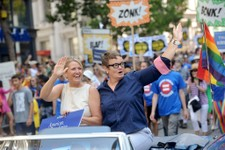 -                Proposition 8 plaintiffs Kris Perry, left, and Sandy Steir ride in San Francisco's 43rd annual gay pride parade Sunday, June 30, 2013. The couple wed on Friday after a U.S. Supreme Cour