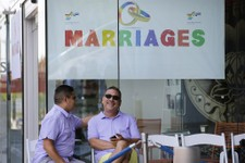 -                Jose Guerrero, left, and Patrick Rodriguez chat before their wedding ceremony in West Hollywood, Calif., Monday, July 1, 2013.  The city of West Hollywood is offering civil marriage cer