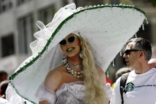 """-                Derik Kleinhesselink, also known as """"Dolly Madison,"""" marches with Starbucks employees at the annual Gay Pride parade Sunday, June 30, 2013, in Seattle. (AP Photo/Elaine Thompson)"""