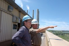 -                Plant manager Neil Dennehy, right, shows Rep. Steve Daines, R-Mont., where the Colstrip Steam Electric Station gets coal from a nearby mine that it burns to produce electricity.  The 2,