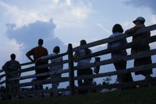 -                Members of the public view a ceremony near Meade's Headquarters on the Gettysburg battlefield during ongoing activities commemorating the 150th anniversary of the Battle of Gettysburg,