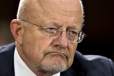 -                FILE - This April 18, 2013 file photo shows National Intelligence Director James Clapper testifying on Capitol Hill in Washington.  Clapper is apologizing for telling Congress earlier t