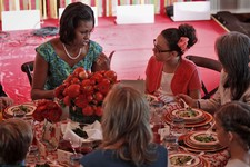 "-                FILE - This Aug. 20, 2012 file photo shows first lady Michelle Obama talking with Illana Gonzalez-Evans, from Washington, during the Kids' ""State Dinner,"" in the East Room of the White"