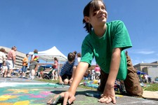 -                FILE - In this July 2007 file photo, Madeline Kara Neumann, of Weston, Wis., is shown working on chalk art last summer during downtown Wausau's Chalk Fest. Neumann died Sunday, March 23