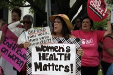 -                People gather outside the state legislature as Senate Republicans gave their final approval to legislation requiring additional rules surrounding abortions in North Carolina, even as hu