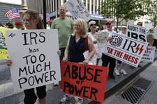 -                FILE - In this Tuesday, May 21, 2013 file photo, tea party activists demonstrate on Fountain Square before marching to the John Weld Peck Federal Building in Cincinnati to protest the I